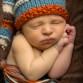 Newborn baby boy photo featuring handmade knit elf hat by Littleton photographer Kristina Lynn Photography & Design