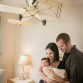 Lifestyle newborn baby and mom and dad photo by Lone Tree photographer Kristina Lynn Photography & Design