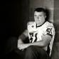 Edgy high school senior football player photo shoot with Littleton photographer Kristina Lynn Photography & Design