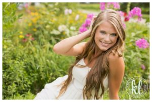 Outdoor senior girl photo session with flowers by Clarion, Iowa photographer Kristina Lynn Photography & Design