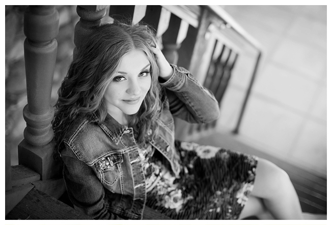 An editorial black and white image of a girl posing on the steps at Highlands Ranch Mansion in Littleton CO | Image by Kristina Lynn Photography & Design.