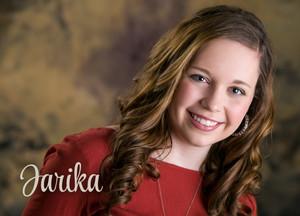 An indoor studio portrait of a high school senior girl | Image by Kristina Lynn Photography & Design.