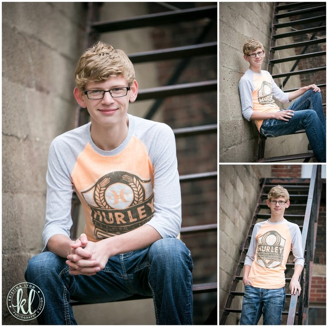 High school senior boy wearing a Hurley graphic tee in an alleway for his senior photos   Image by Kristina Lynn Photography & Design