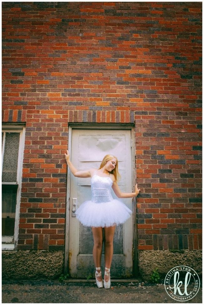 A ballerina senior photo session photographed in an urban alley in Clarion Iowa.