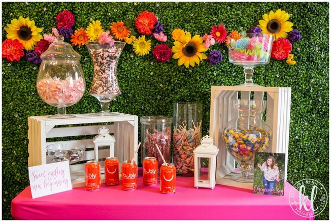 A bright and colorful graduation party theme with a custom flower backdrop. Designed by Twin Cites photographer Kristina Lynn.